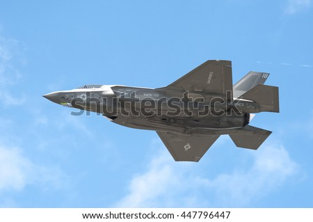 FARNBOROUGH, UK - JULY 5: Low level flight by a Lockheed Martin F-35B Lightning II in the skies over Farnborough, Hampshire, UK on July 5, 2016 - stock photo