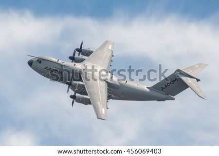 FARNBOROUGH, UK - JULY 16: Propeller vortex spinning over the wings of an Airbus A400M military transporter aircraft after take-off from Farnborough, Hampshire, UK on July 16, 2016 - stock photo