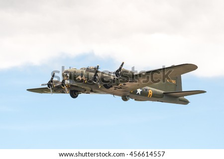 FARNBOROUGH, UK - JULY 17: Vintage Boeing B-17 Flying Fortress bomber in the skies over Farnborough, UK on July 17, 2016 - stock photo