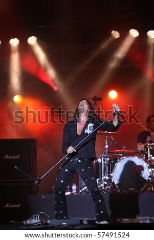 FARO, PORTUGAL - JULY 15: Gotthard swiss band performs onstage at  Internacional motorcycle show July 15 2010 in Faro, Portugal. - stock photo
