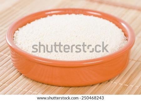 Farofa - Bowl of toasted manioc flour. Traditional Brazilian side dish. - stock photo