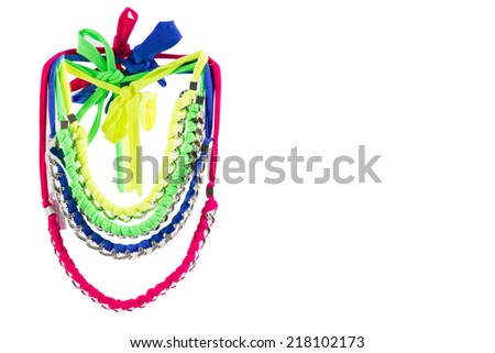 Fashion accessories: very colourful necklaces made by weaving lycra ribbons and metal chains together. White background. - stock photo