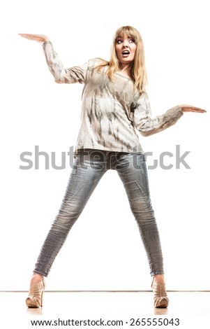 Fashion and advertisement concept. Full length woman surprised face expression holding open palm empty hand showing copy space for product isolated - stock photo