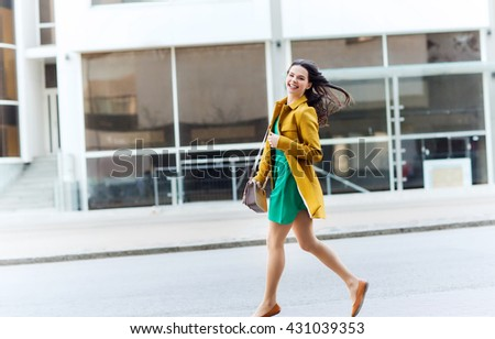 fashion and people concept - happy young woman or teenage girl running on city street - stock photo
