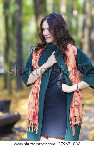 Fashion and Style Concept: Portrait of Young Caucasian Brunette Female in Made to Measure Clothing. Outdoors Photoshot. Vertical image - stock photo