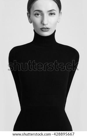 fashion art beauty monochrome portrait.model girl in a black roll neck jumper.Sensual black and white woman - stock photo