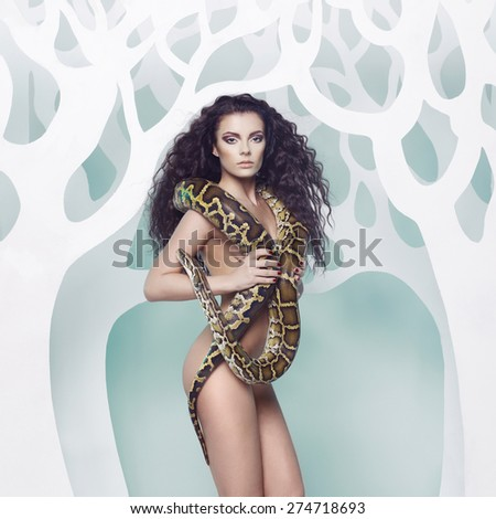 Fashion art photo of beautiful nude woman with python - stock photo