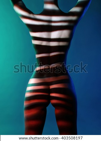 Fashion art studio photo of elegant naked lady with shadows on her body - stock photo