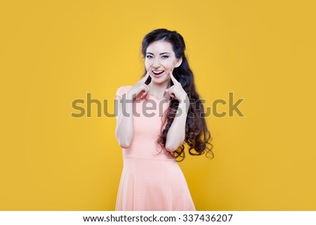Fashion asian young  girl. Portrait on yellow background.  - stock photo