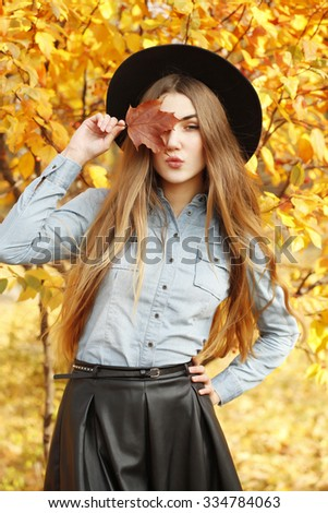 Fashion autumn portrait of stylish woman, posing on the street. Seductive glamorous hipster girl wearing stylish clothes posing outside on a sunny day - stock photo