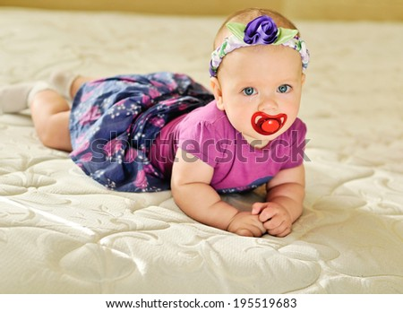 fashion baby girl with tears in eyes - stock photo