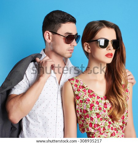 fashion beautiful couple in sunglasses. woman near the man.beauty girl and boy together.summer style - stock photo