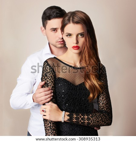 fashion beautiful couple.woman near the man.beauty girl and boy together - stock photo