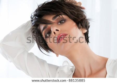 Fashion beautiful female model posing in natural bright light - stock photo