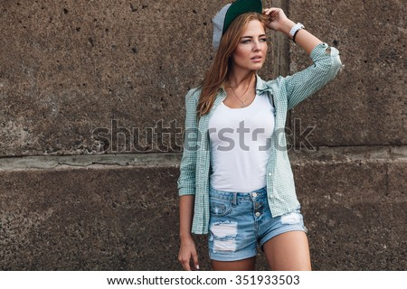 fashion beautiful girl posing near concrete wall - stock photo