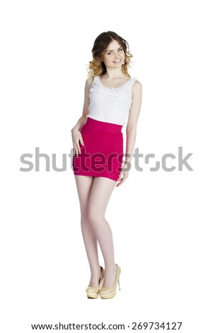 Fashion beautiful girl with modern white blouse and res skirt posing in studio, isolated on white - stock photo