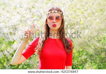 Fashion beautiful hippie woman having fun in flowering garden - stock photo