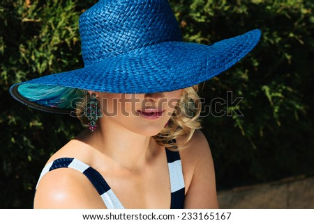 Fashion beautiful woman sunbathing on a chaise lounge near pool outdoors. Vogue style - stock photo