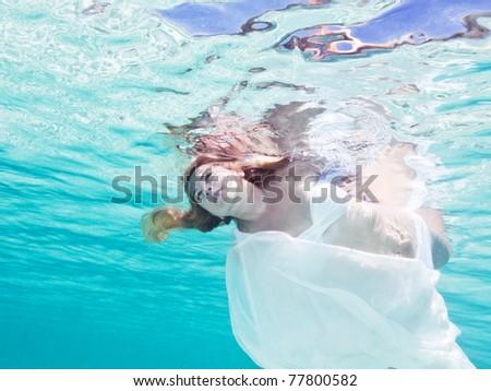 Fashion beautiful woman underwater like a mermaid - stock photo