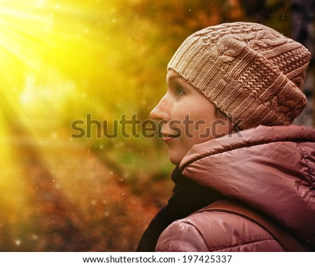Fashion beautiful woman walking in autumn park. - stock photo