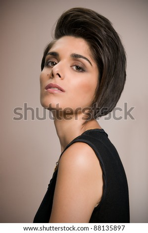 Fashion beautiful young woman posing with straight short hair - stock photo