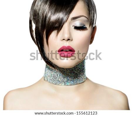 Fashion Beauty Girl. Gorgeous Woman Portrait. Stylish Haircut and Makeup. Hairstyle. Make up. Vogue Style. Fringe. Long Eyelashes. Sexy Glamour Girl  - stock photo