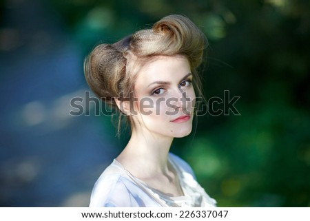 Fashion Beauty Girl. Gorgeous Woman Portrait. Stylish Haircut and Makeup. Hairstyle. Make up. Vogue Style. Sexy Glamour Girl. Outdoor - stock photo