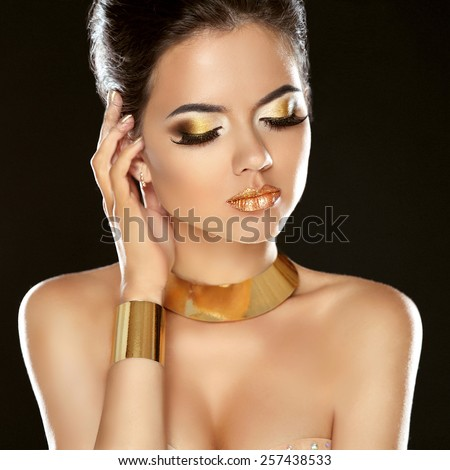 Fashion Beauty Girl Isolated on Black Background. Golden Jewelry. Makeup. Hairstyle. Vogue Style. - stock photo