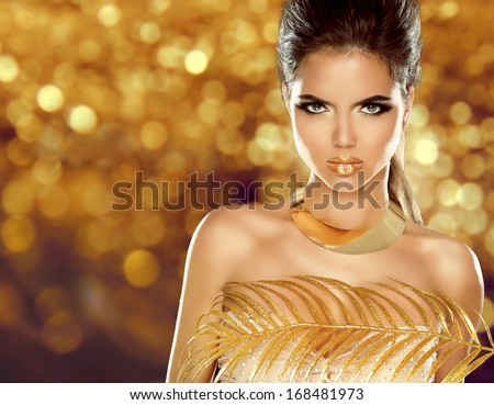 Fashion Beauty Girl Isolated on golden bokeh Background. Makeup. Gold Jewelry. Hairstyle. Vogue Style. - stock photo