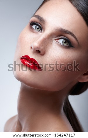 Fashion Beauty Makeup. Beautiful Woman With Red Lips and Luxury Makeup. Beautiful Face - stock photo