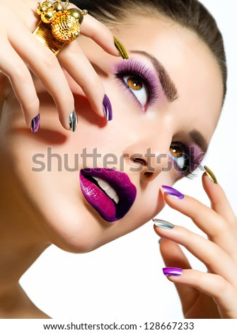Fashion Beauty . Manicure and Make-up. Nail Art. Beautiful Woman With Colorful Nails and Luxury Makeup. Beautiful Girl Face and Hand - stock photo