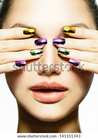 Fashion Beauty. Manicure and Make-up. Nail art. Beautiful Woman With Colorful Nails and Luxury Makeup. Beautiful Girl Face and Hand - stock photo