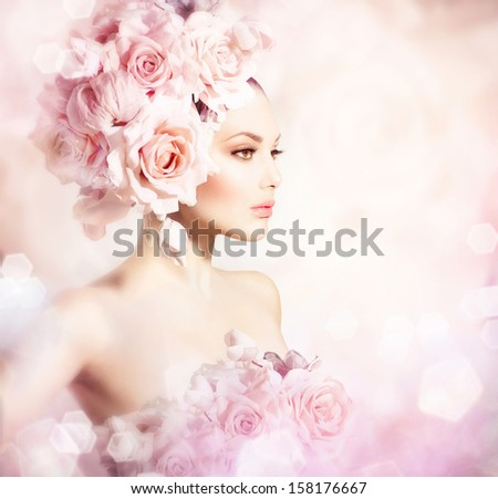 Fashion Beauty Model Girl with Flowers Hair. Bride. Perfect Creative Make up and Hair Style. Hairstyle. Bouquet of Beautiful Flowers.  - stock photo