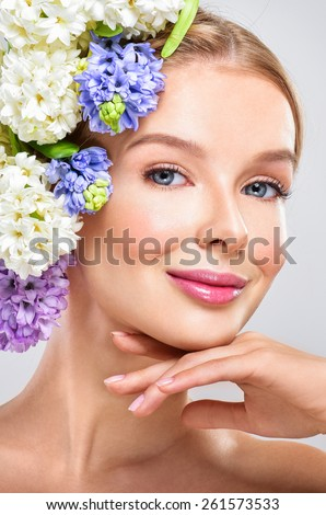 Fashion Beauty Model Girl with flowers in the hair. Bouquet of Beautiful Flowers. Perfect skin - stock photo