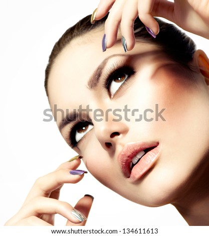 Fashion Beauty Model. Vogue Style Glamour Woman. Manicure and Make-up. Nail Art. Beautiful Girl With Colorful Nails and Luxury Makeup. Beautiful Girl Face and Hand - stock photo