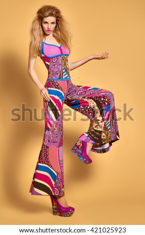 Fashion beauty sexy model in stylish bright clothes. Blonde woman in colorful luxury summer dress, glamor shoes with volume hairstyle, make up. Expressive playful vivid girl. Unusual creative lady.  - stock photo