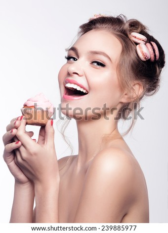 fashion beauty smile girl with macaroons on the hair and cape cake  in hands - stock photo