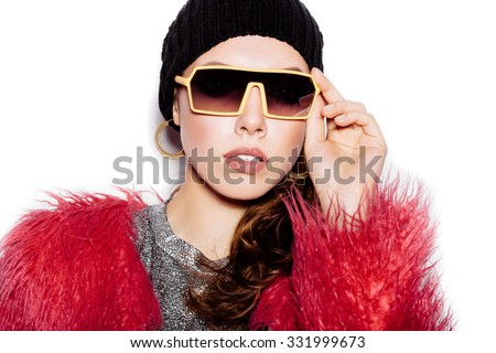 Fashion Beauty Swag Girl wearing silver dress, pink fur coat, black beanie hat. Stylish Haircut and Makeup. Close-up of young Woman on white background no isolated - stock photo