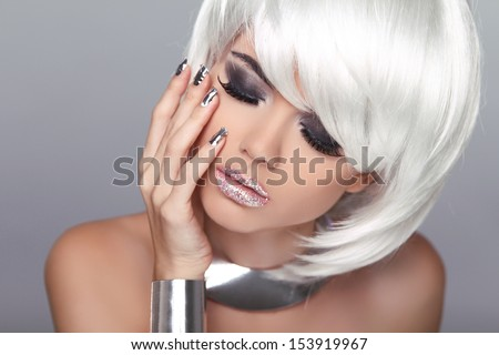 Fashion Blond Girl. Beauty Portrait Woman. White Short Hair. Isolated on Grey Background. Face Close-up. Hairstyle. Fringe. Vogue Style. - stock photo