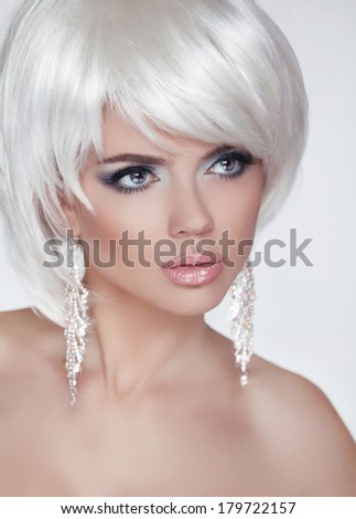 Fashion Blond Woman Portrait with White Short Hair. Luxury Girl. Jewelry. Haircut and Makeup. Hairstyle. Make up. Vogue Style. Glamour Model Photo - stock photo