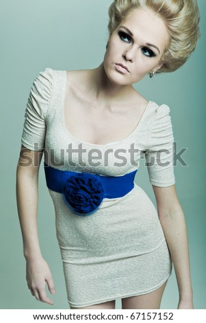 Fashion blonde looks in the direction - stock photo