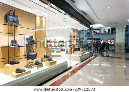 fashion boutique storefront in shopping mall - stock photo