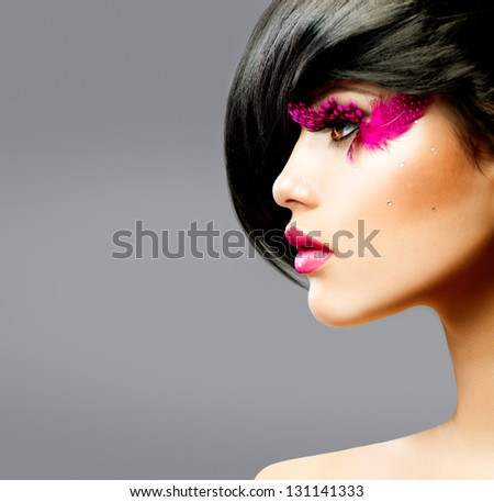 Fashion Brunette Model Profile Portrait. Hairstyle. Haircut. Hairdressing. Professional Makeup. False Feather Eyelashes. Fashion Art. Vogue Style - stock photo