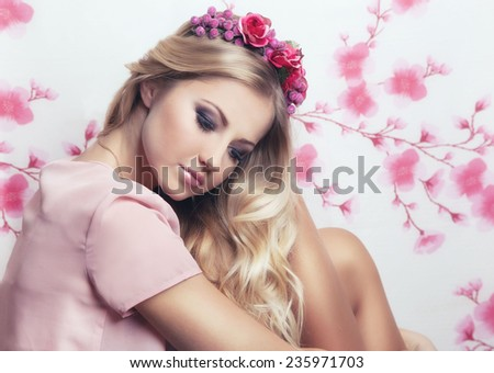 Fashion close up portrait of tender sensual pretty girl, with perfect skin and smoky make up. Provence style in pink colors. - stock photo