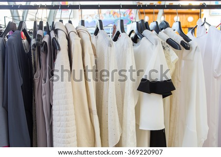 Fashion cloth of women on rack - stock photo