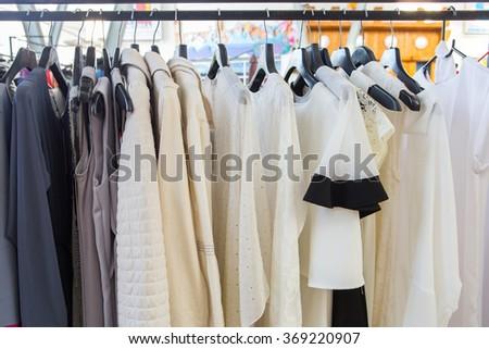 Fashion cloth of women on rack - stock photo