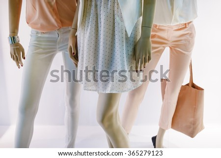 Fashion concept. Photo of elegant female legs mannequins showing clothing and accessories. Shallow depth of field. Selective focus. - stock photo