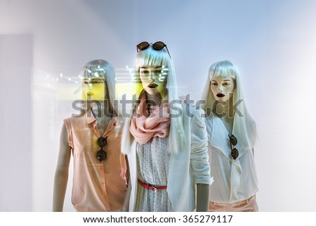 Fashion concept. Photo of three elegant female mannequins showing clothing and accessories. - stock photo