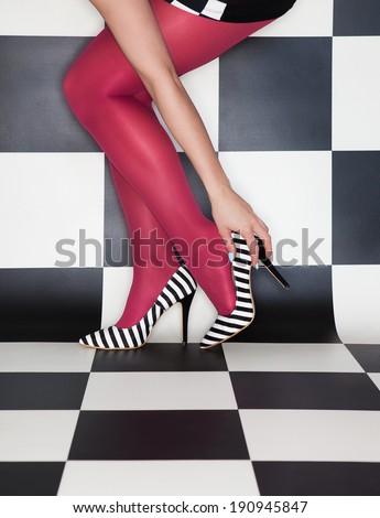 Fashion concept woman wearing high heels stilettos legs close up - stock photo