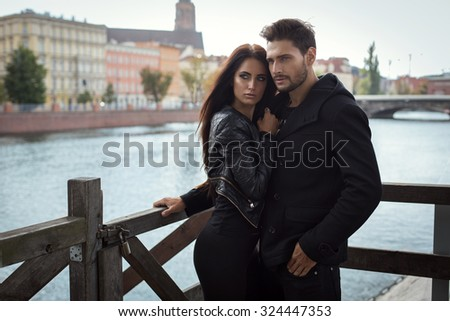 Fashion couple hugging each other - stock photo
